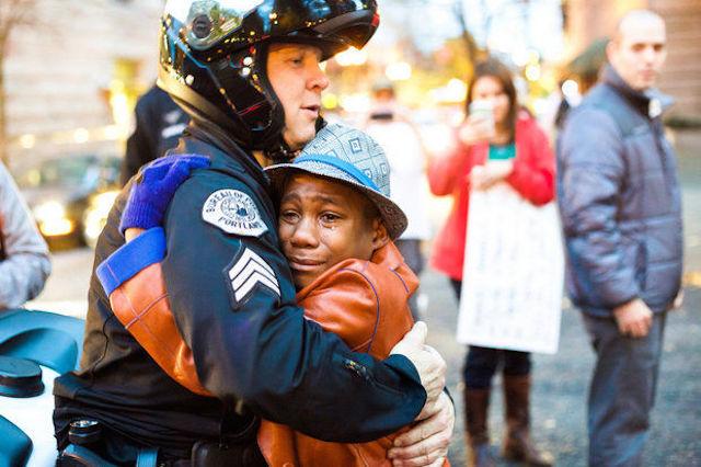 Portland Police Sgt. Bret Barnum hugging 12-year-old Devonte Hart